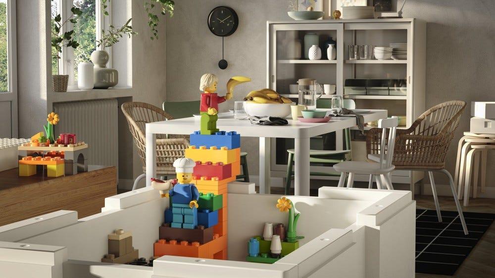 A closeup of a White box with LEGO bricks built into it.