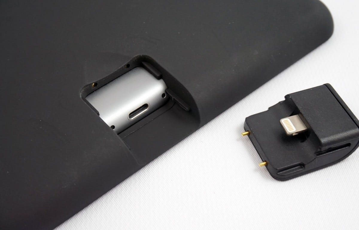 The pass-through Lightning port can be removed to plug in a cable.