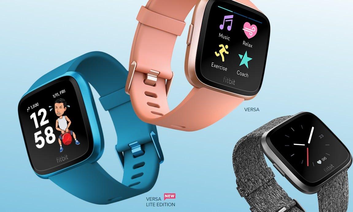 A pink Fitbit Versa, blue Fitbit Versa Lite, and grey Fitbit Versa