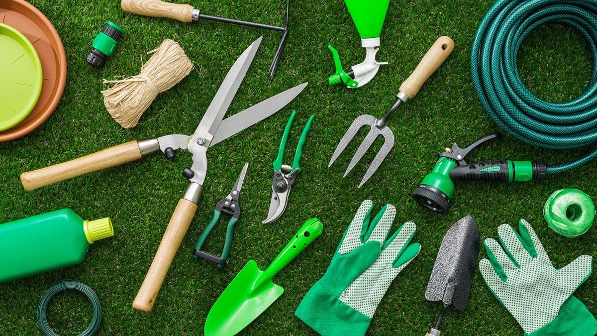Gardening tools spread out on a lawn