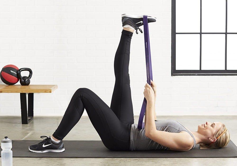 Resistance band leg stretch.