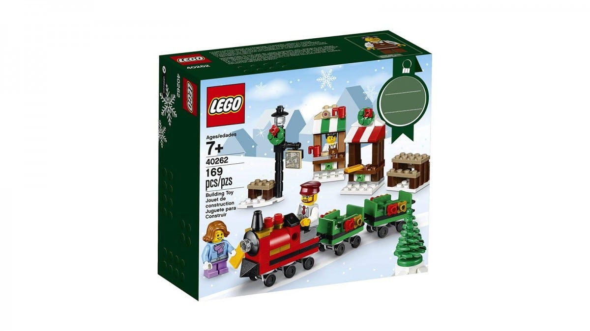 A box displaying a LEGO train with a Christmas theme.