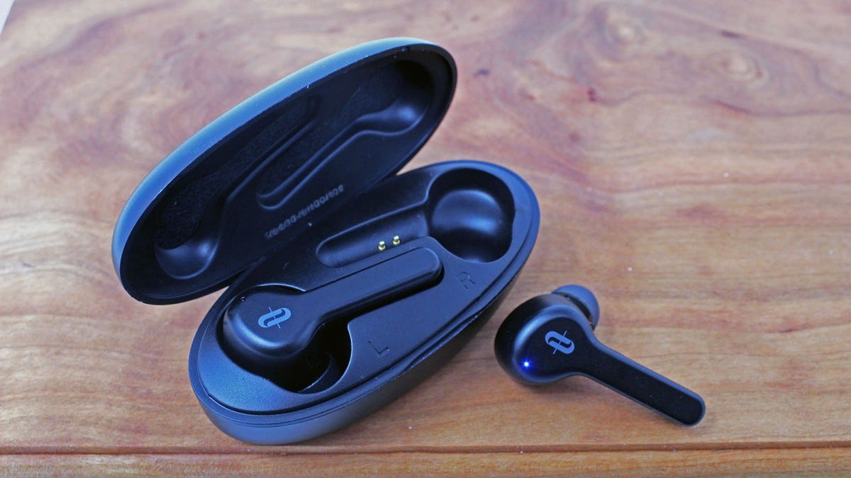 TaoTronics SoundLiberty set, with one earbud out of case and blue light showing.