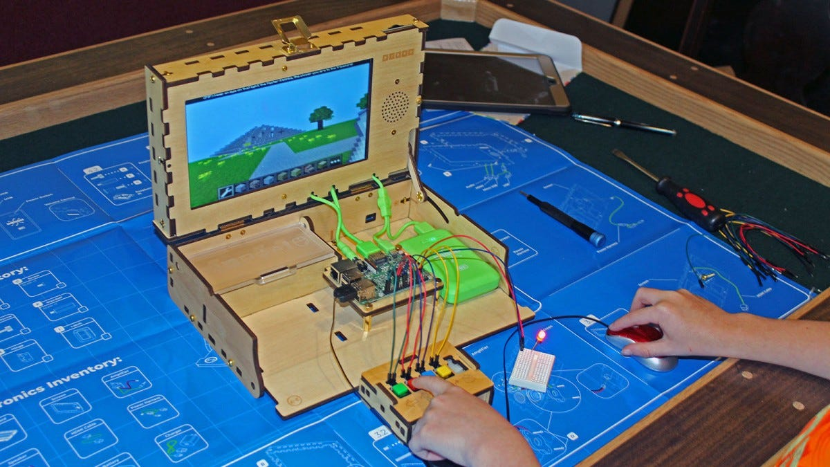 The kit with a three button controller and a second breadboard with red LED light.