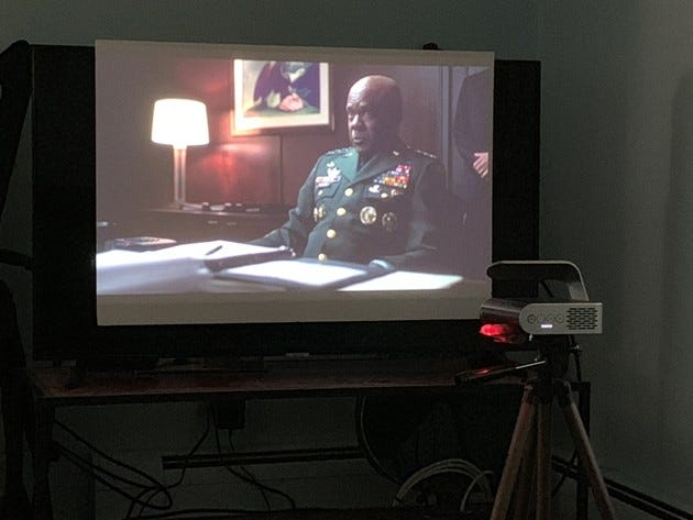 The M1+ projecting a movie onto a small screen