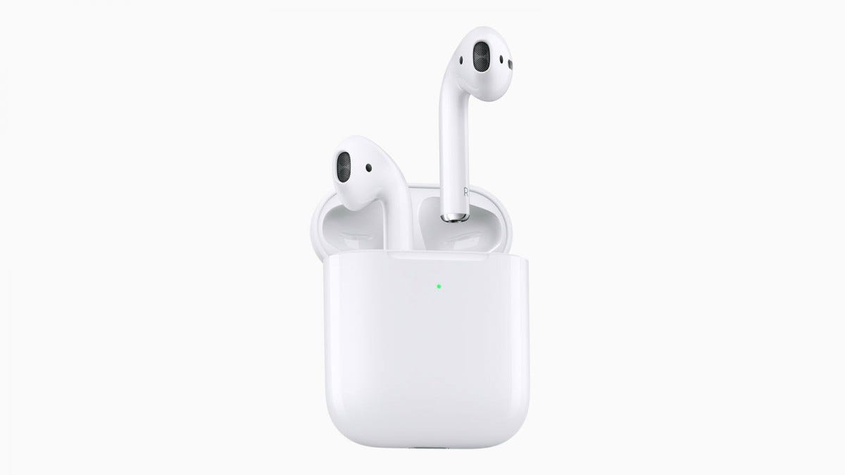 A set of Airpods with a wireless charging case.