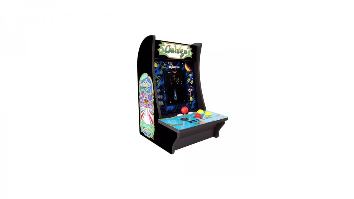 A Galaga countertop arcade with red joysticks and original artwork.