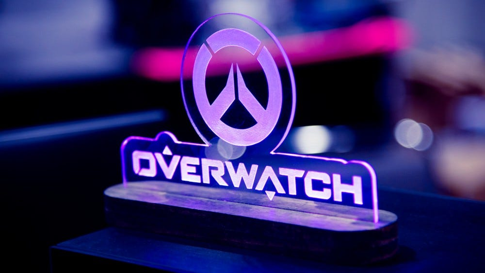 Blizzard's Overwatch game logo in glass lit up from below