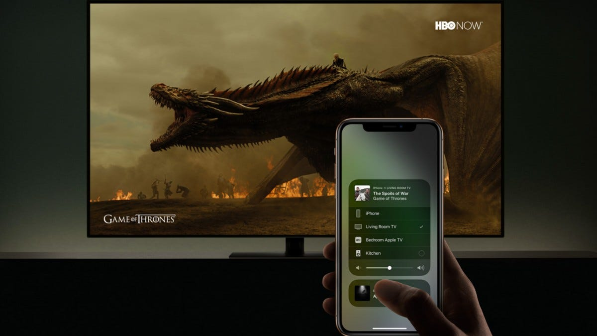 A man using AirPlay to cast Game of Thrones to his TV.