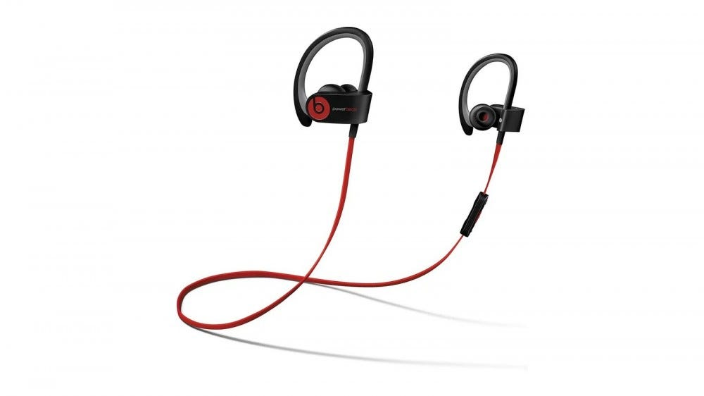 A pair of Powerbeats 2 earbuds with a red cord.