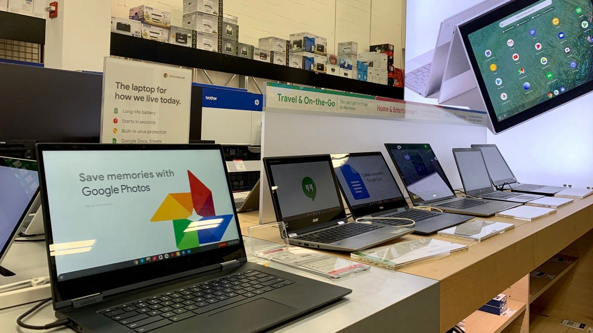 A line of Chromebooks at an electronics store.