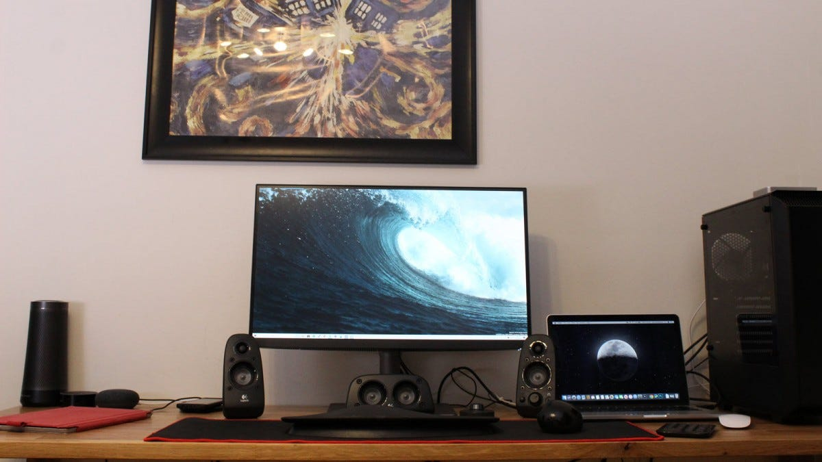 The BenQ PD2720U monitor on a desk with Mac and PC.