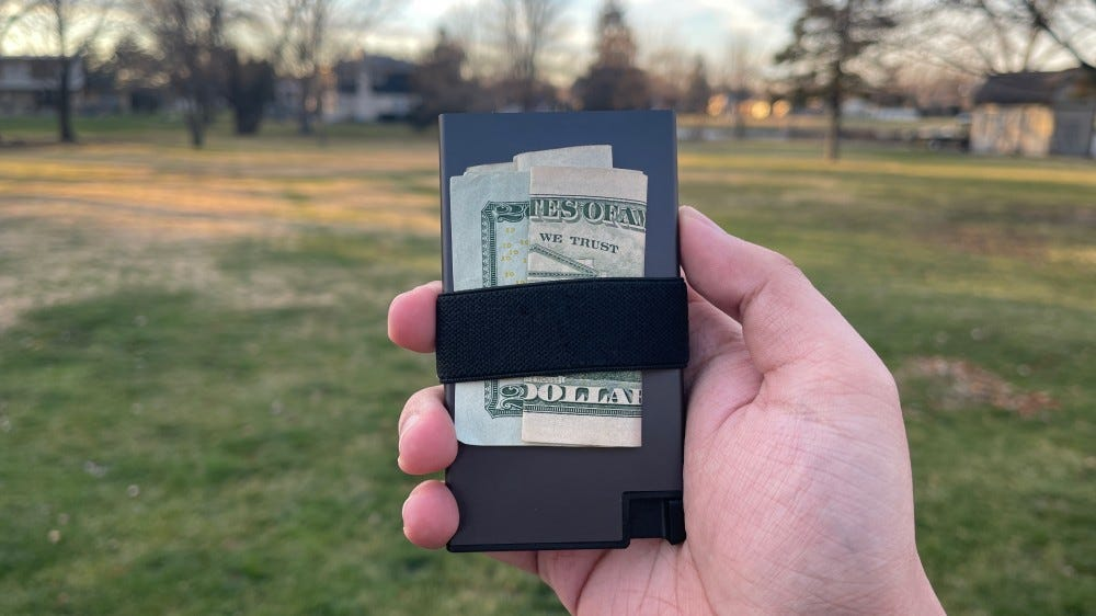 Ekster Aluminum Cardholder with a grass background