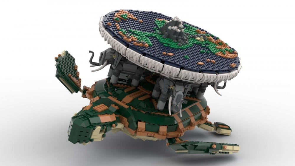 A LEGO flat plannet atop four elephants riding a turtle.