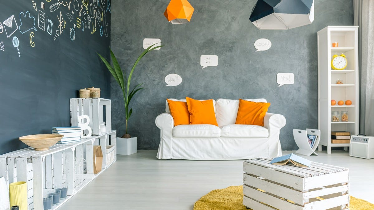 A living room decorated with milk crate furniture