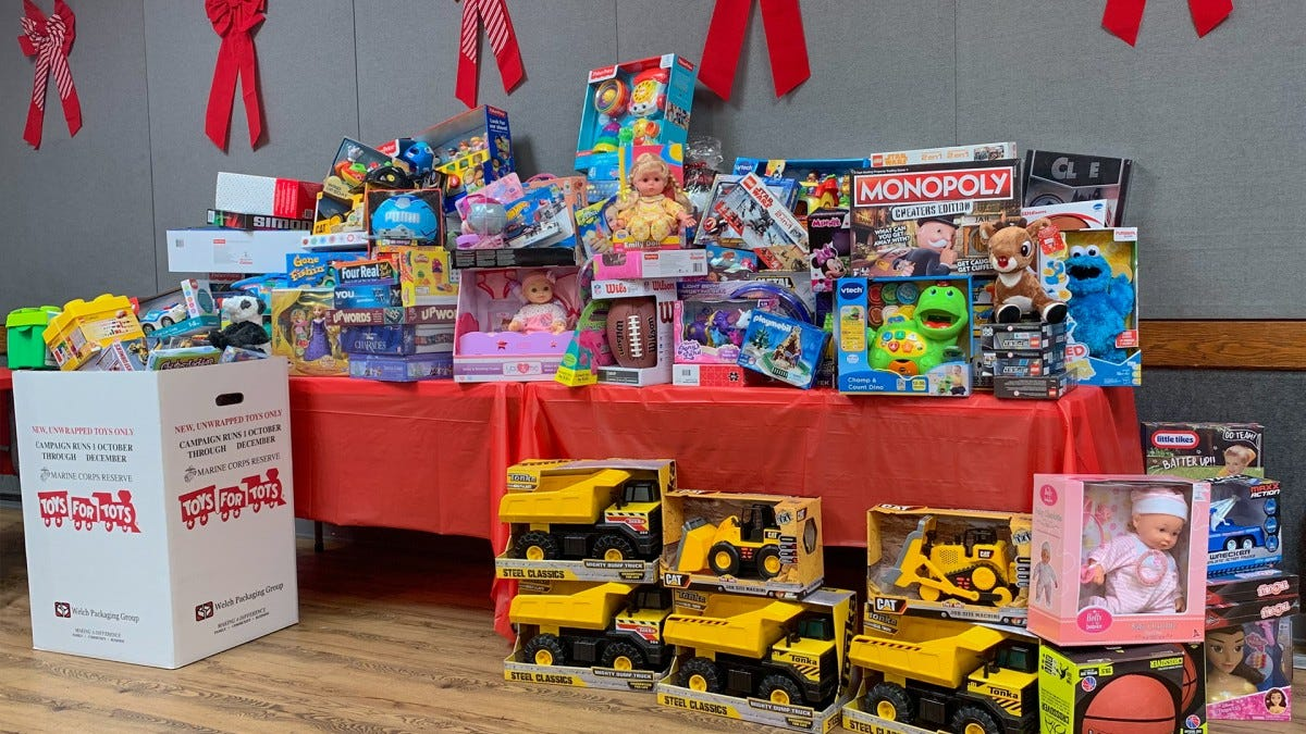 A Toys for Tots table overflowing with toys.
