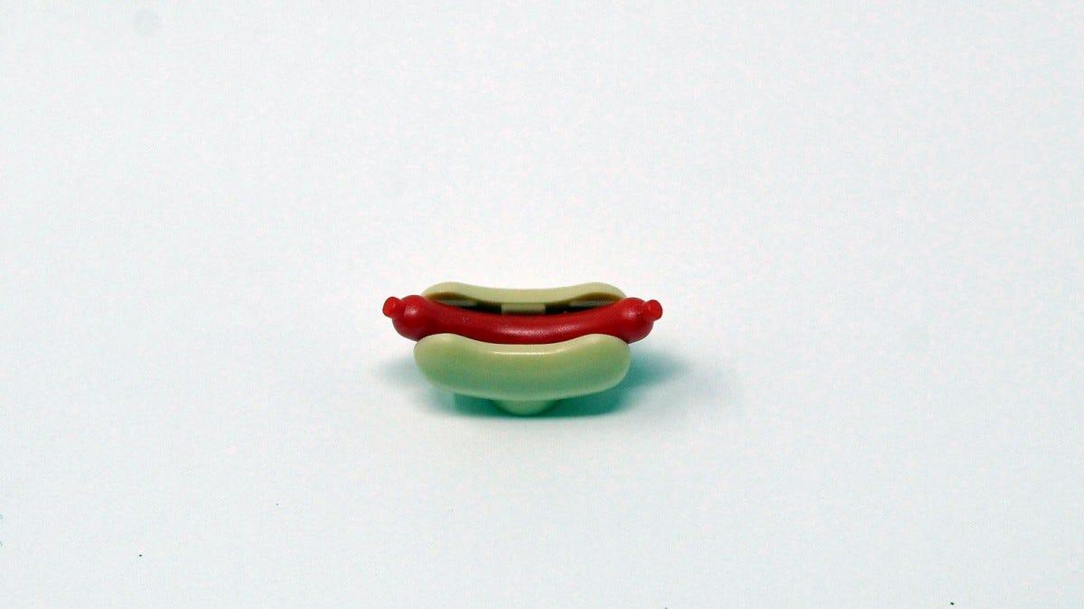 A LEGO hot dog in a hot dog bun.