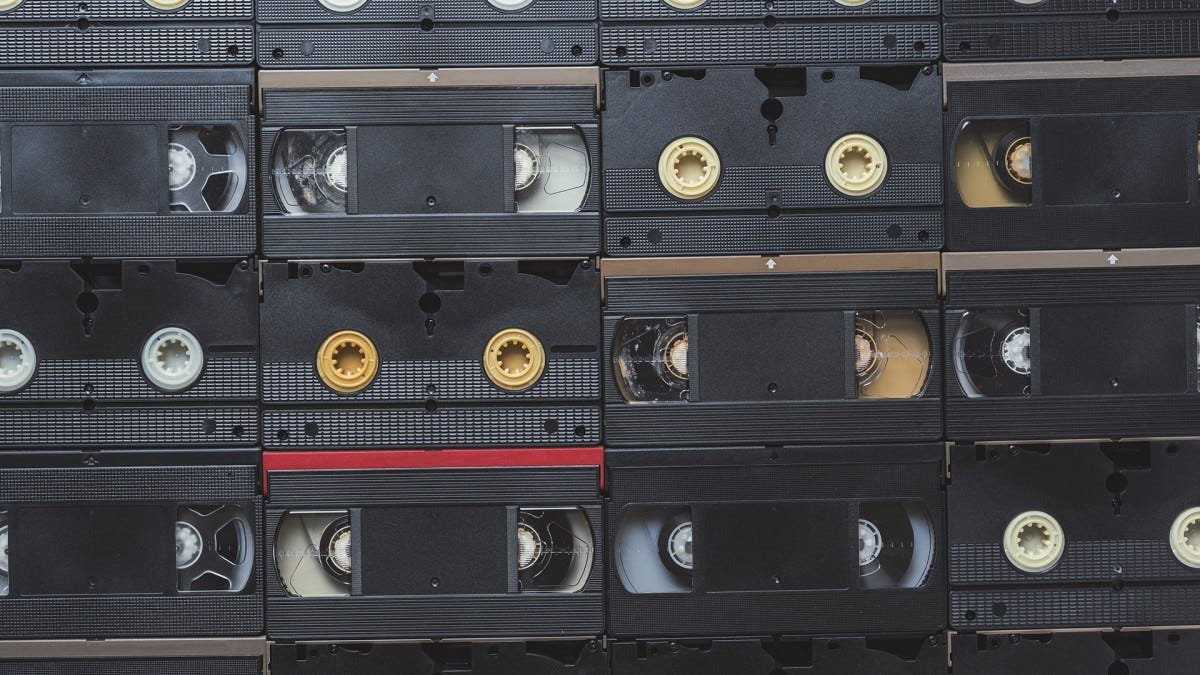A bunch of VHS tapes arranged in horizontal lines.