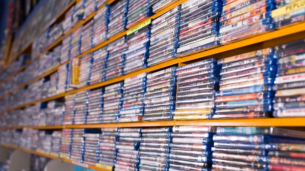 A ridiculous amount of Blu-rays on a long shelf.