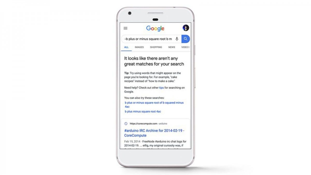An iPhone with a message from Google warning of bad search results.