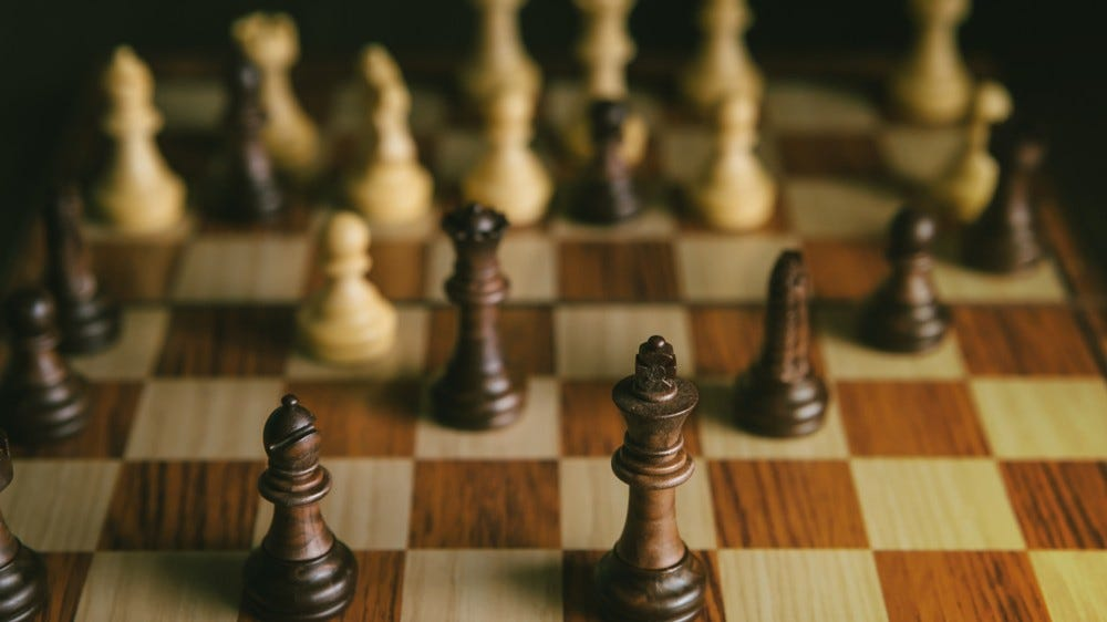 a chess game on a wooden board
