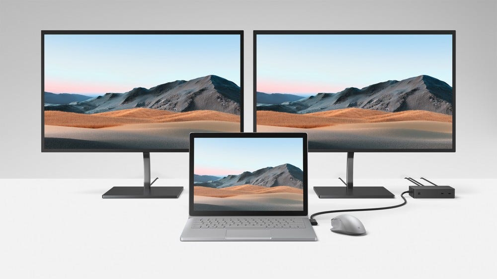 A photo of the Surface Book 3 with two external monitors.