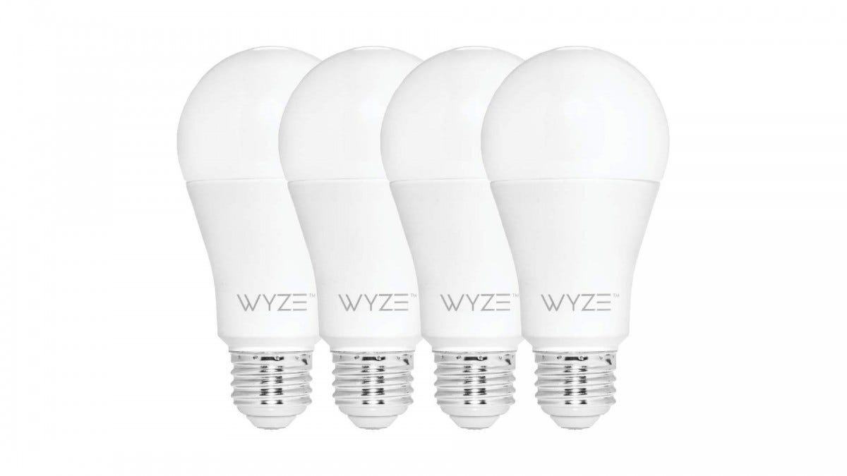 A set of four Wyze smart bulbs.