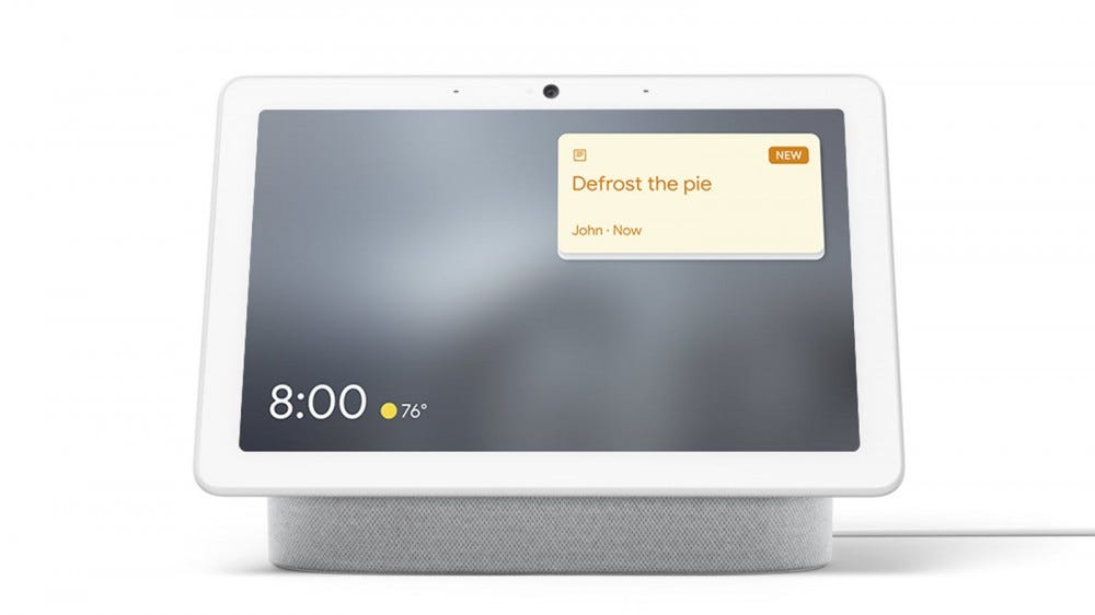 A Nest Hub Max with a sticky note on it reminding to defrost the pie.
