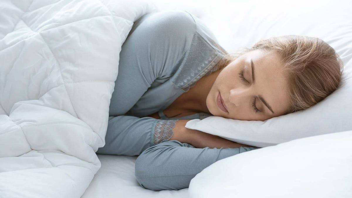 Woman, sleeping on her side