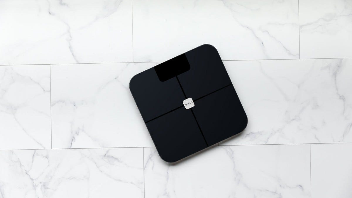A Wyze Scale on a tile floor.