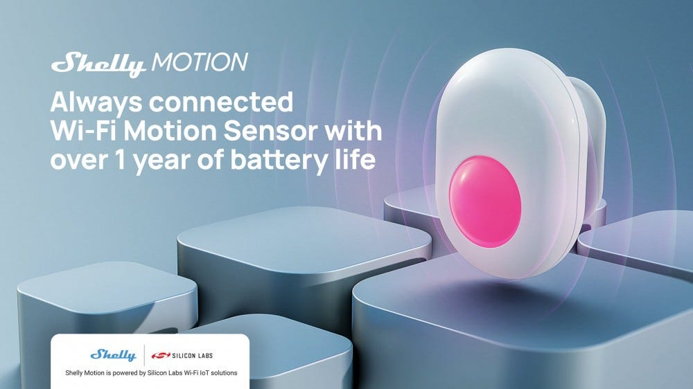 A motion sensor on a gray background with a red light shining.