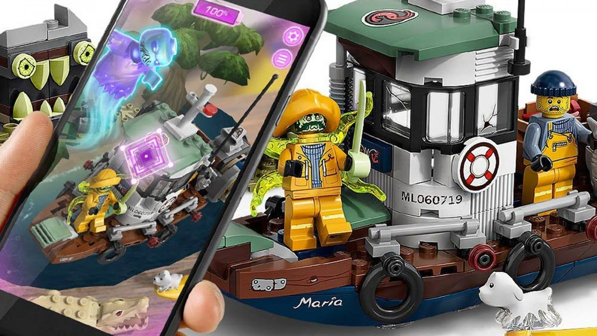 A phone showing a ghost moving over a LEGO boat set.