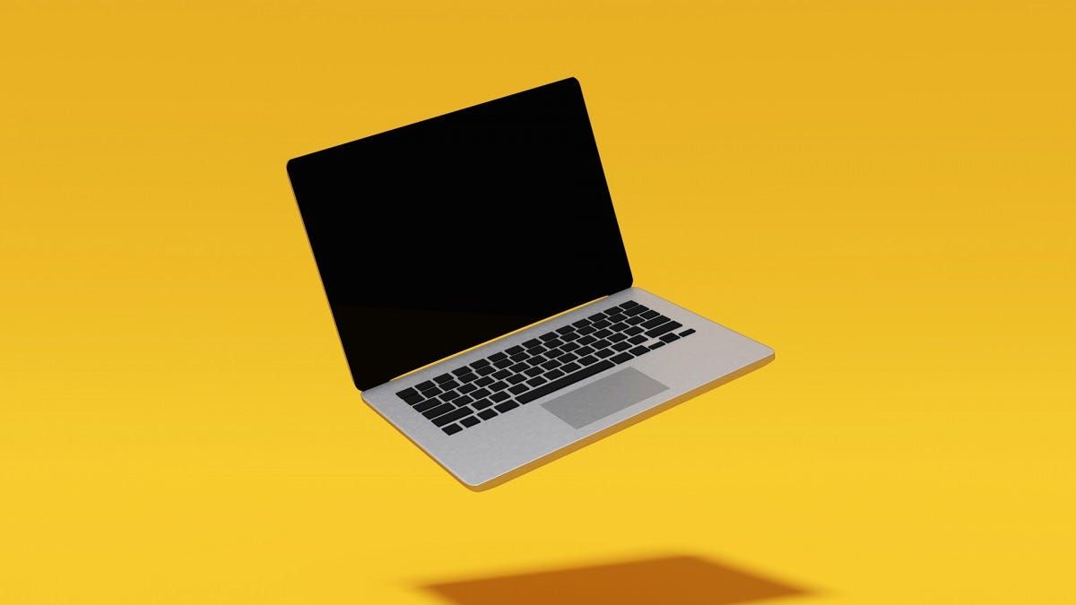 A slim laptop floating against a yellow background.