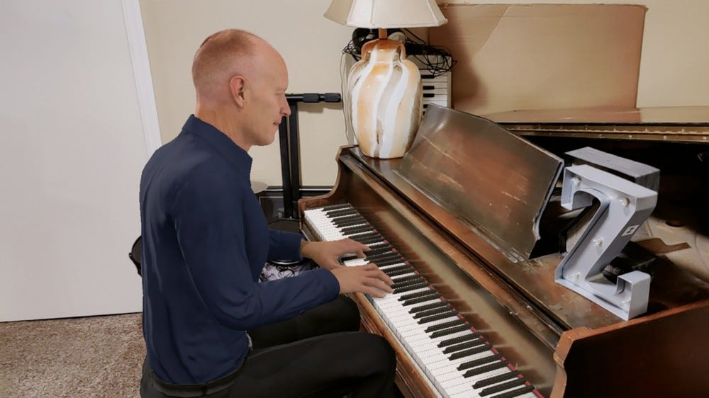 A CGI Jon Schmidt from the Piano guys super imposed over a real piano.