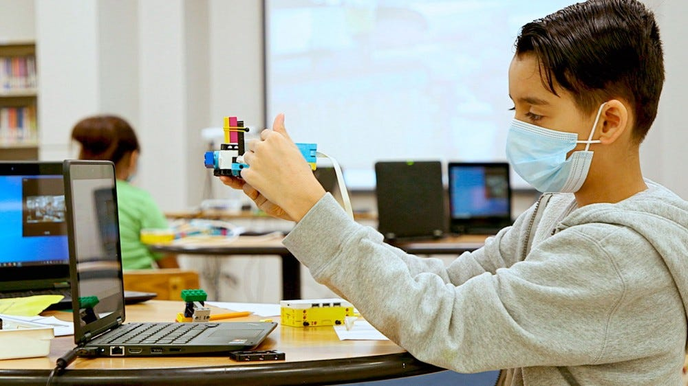 A child using LEGO Education tools.