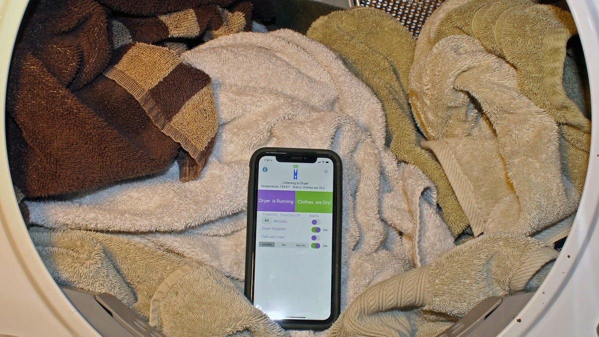 The SmartDry app on a phone that's in a dryer full of towels.