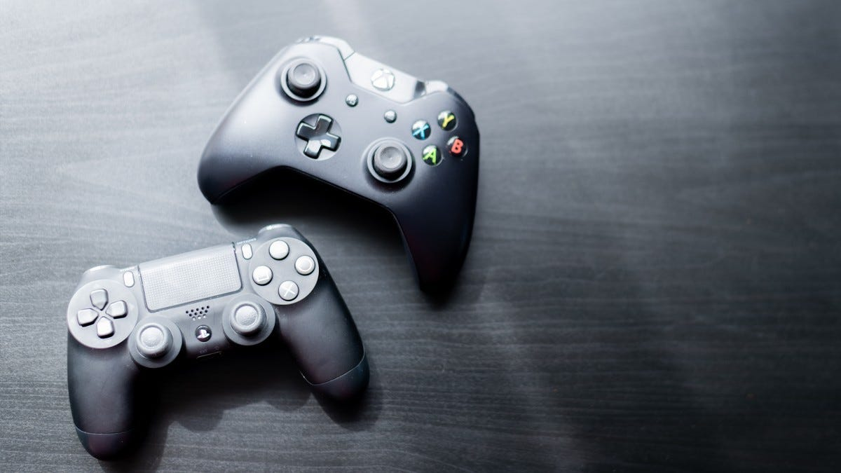 A photo of the Xbox and PlayStation controllers on a table.