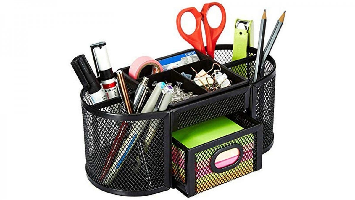 The AmazonBasics DSN-09250 organizer filled with pens, pencils, scissors, tape, paper clips, and Post-its.