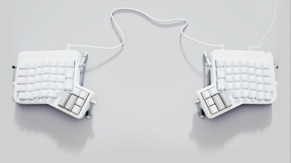 ErgoDox EZ split keyboard on a white backdrop