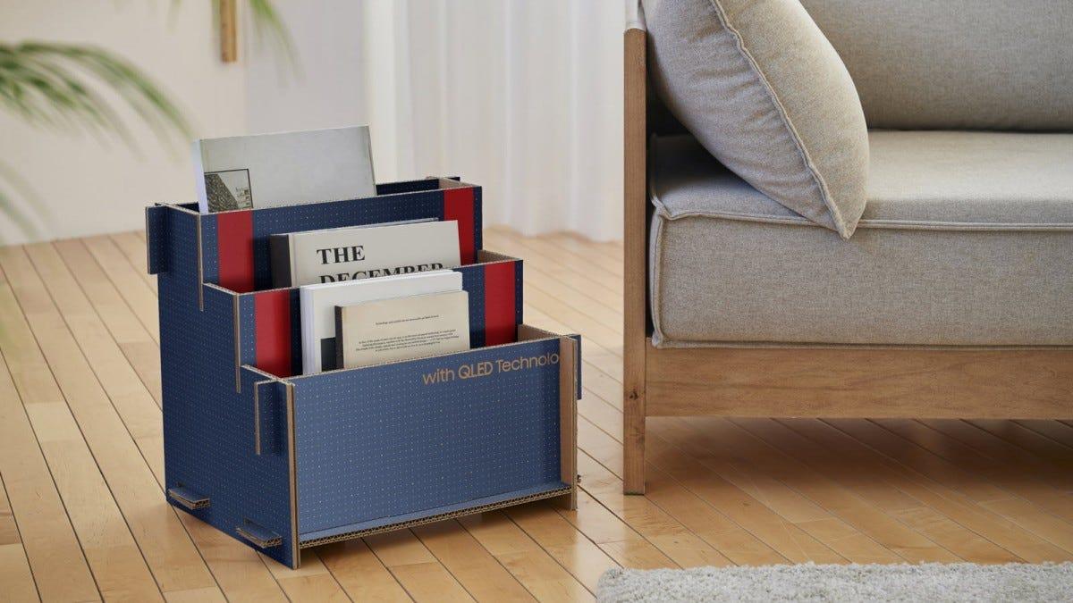 A TV box folded into a magazine rack.