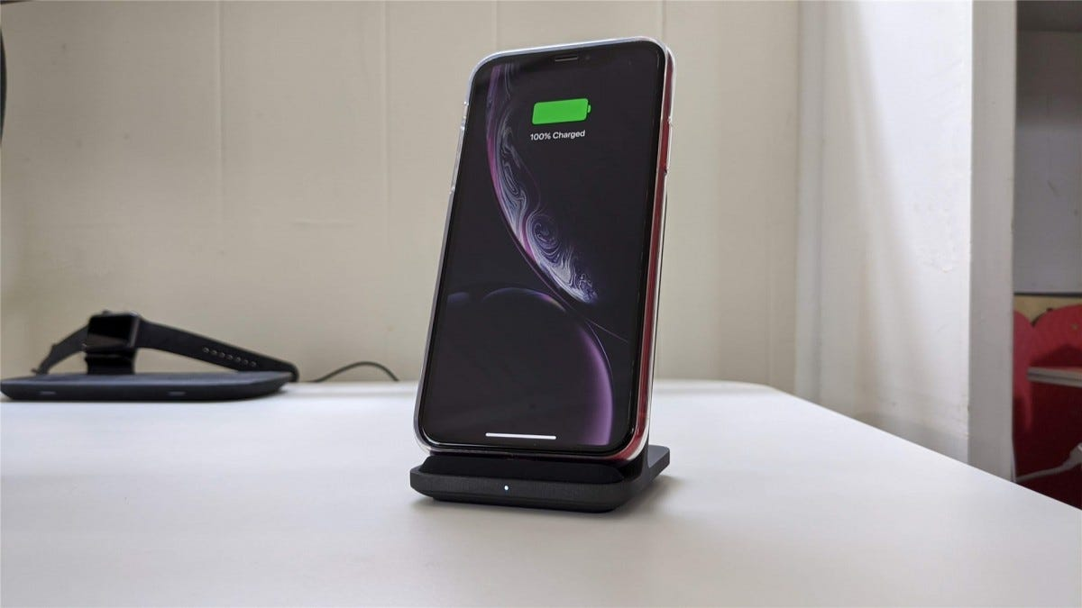 The iPhone XR on the Base Station Stand, charging