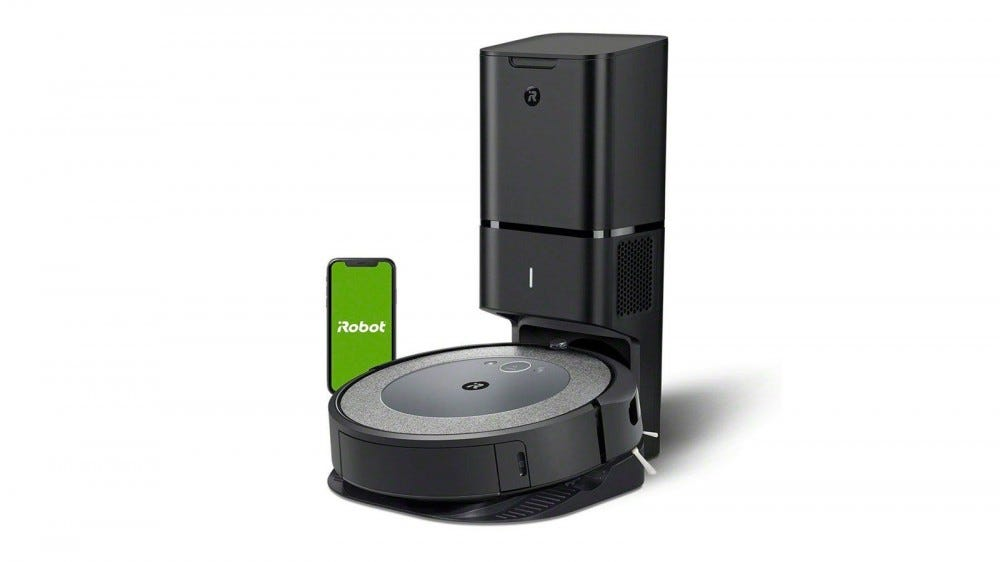 An iRobot Roomba i3+ connected to a self-emptying station.