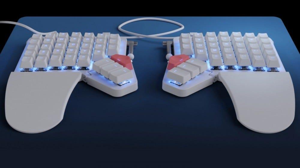 Moonlander Mark 1 split keyboard on blue and black backdrop