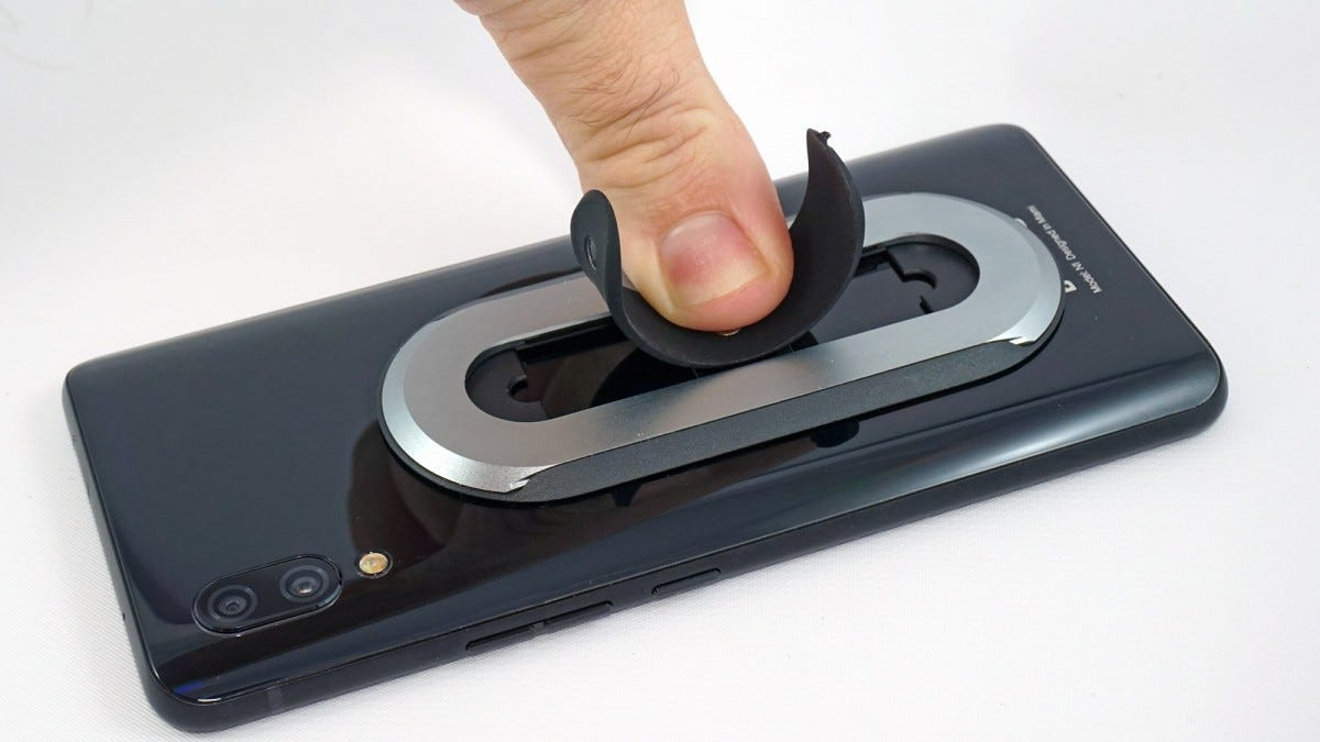 The Ohsnap's ring deploying with a finger press