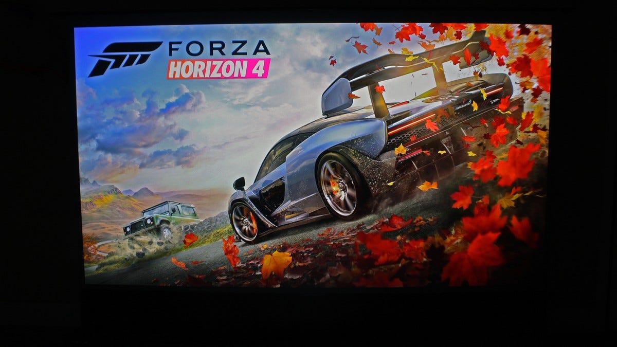 The Forza Horizon 4 splash screen on a 100-inch screen.