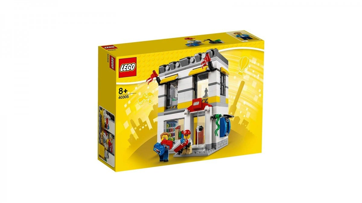 A LEGO Store made of LEGO on a yellow box.