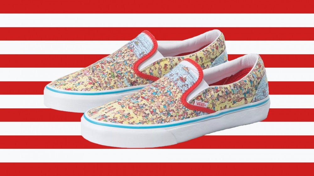 """A pair of Vans slip-ons featuring a """"Where's Waldo"""" spread against a red and white striped background"""