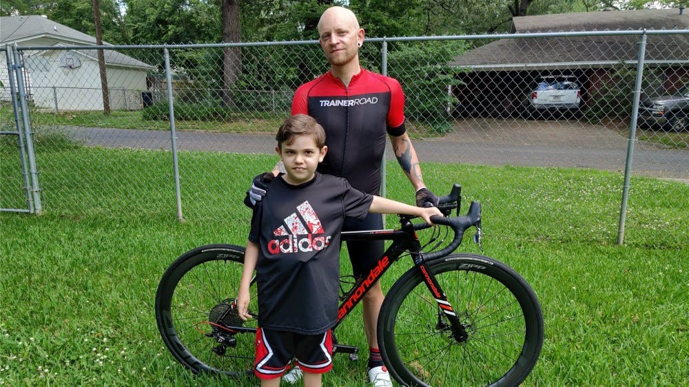 Me with my son Ax and my bike outside