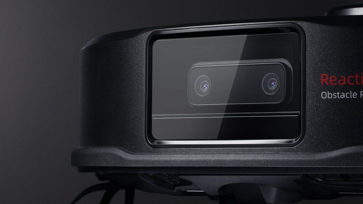 A closeup of a robot vacuum dual camera system.