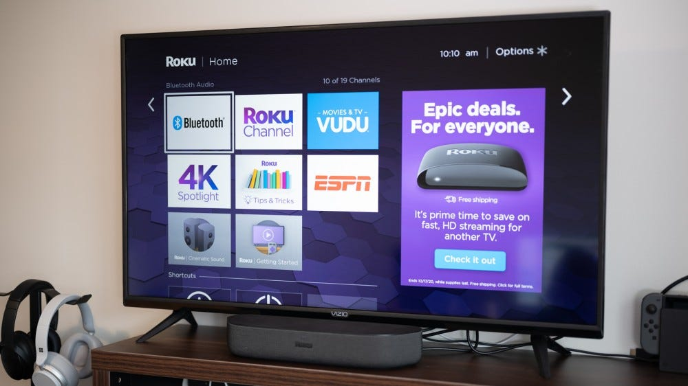 Roku Streambar in front of a television